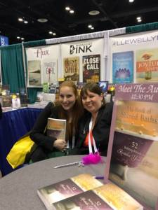 "Signing ""The Book of Sacred Baths"" for a fan at ALA Orlando Event."